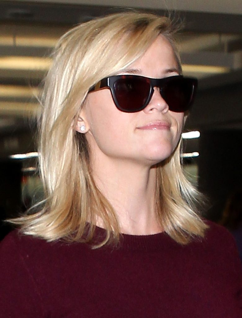 reese witherspoon arrives at the los angeles international airport
