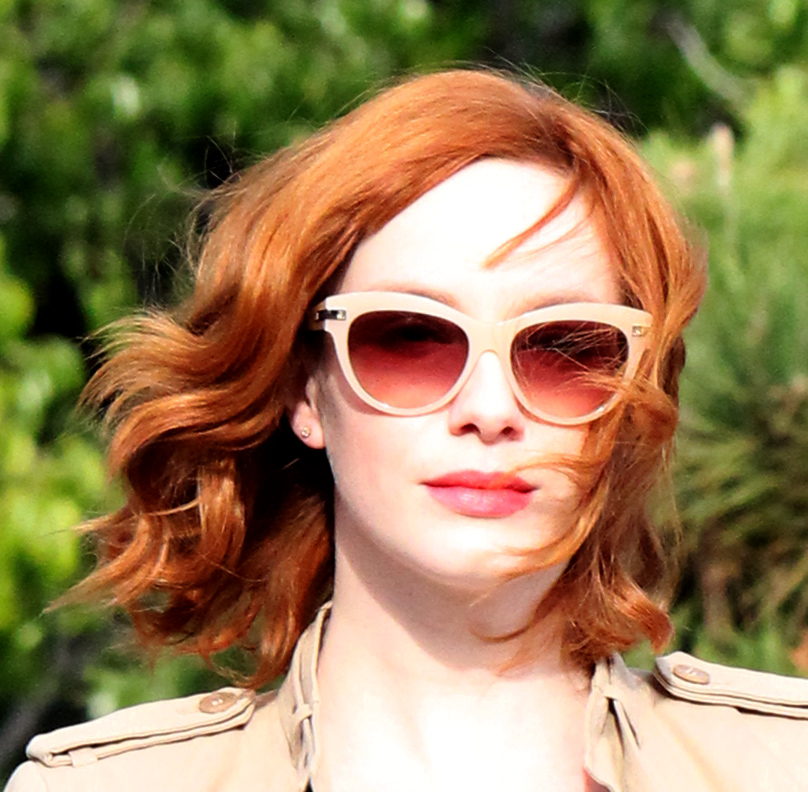 Beverly Hills-March 24,2014:EXCLUSIVE: Christina Hendricks almost gets run over by a car while jay walking quickly across a street to keep up with her busy schedule and get to shop at the XIV Karats jewelry store on March 24, 2014 in Beverly Hills Califor