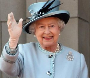 LONDON, ENGLAND - JUNE 11: Queen Elizabeth II waves from the balcony of Buckingham Palace after the Trooping the Colour parade on June 11, 2011 in London, England. The ceremony of Trooping the Colour is believed to have first been performed during the reign of King Charles II. In 1748, it was decided that the parade would be used to mark the official birthday of the Sovereign. More than 600 guardsmen and cavalry make up the parade, a celebration of the Sovereign's official birthday, although the Queen's actual birthday is on 21 April. (Photo by Dan Kitwood/Getty Images)