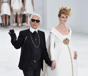 PARIS, FRANCE - JULY 08: Fashion designer Karl Lagerfeld (L)and model Ashleigh Good aknowledge the applause of the audience after the Chanel show as part of Paris Fashion Week - Haute Couture Fall/Winter 2014-2015 at Grand Palais on July 8, 2014 in Paris, France. (Photo by Pascal Le Segretain/Getty Images)