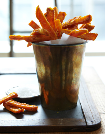 Rustic sweet potato fries with salt on the side.