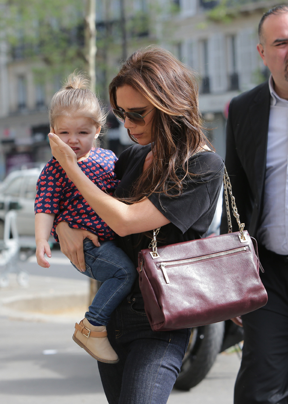 Victoria Beckham and daughter Harper at Bon Ton's Hair Cut Store in Paris.