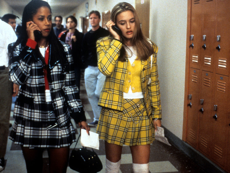 Stacey Dash and Alicia Silverstone walking and talking on their mobile phones in a scene from the film 'Clueless', 1995. (Photo by Paramount Pictures/Getty Images)