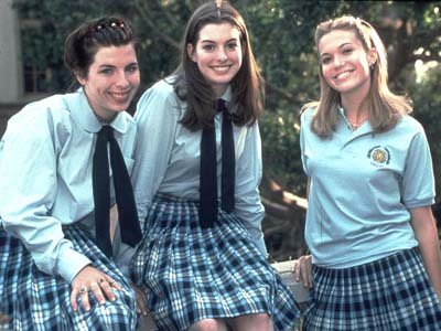 Heather Matarazzo (L) ÊAnne Hathaway (C) and Mandy Moore (R) in a film still from The Princess Diaries. 2001 (Courtesy of Buena Vista Pictures-Fashion Wire Daily)