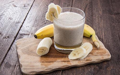 Fresh made Banana Milkshake on wooden background