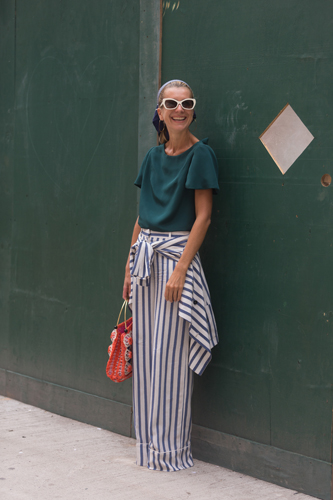 NEW YORK, NY - SEPTEMBER 08: Tales of Endearment blogger Natalie Joos wears an Audra top, vintaga raffia bag, and Tommy Hilfiger pants on Day 5 of New York Fashion Week Spring/Summer 2015 on September 8, 2014 in New York City. (Photo by Melodie Jeng/Getty Images)