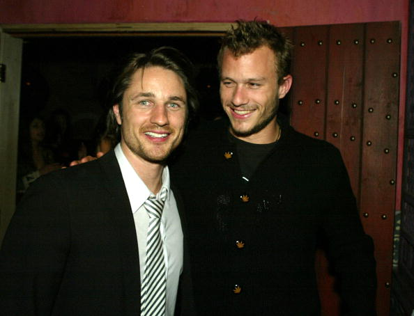 "LOS ANGELES - JANUARY 14: Actors Martin Henderson (L) and Heath Ledger pose at the after-party for Warners' ""Torque"" at Avelon on January 14, 2004 in Los Angeles, California. (Photo by Kevin Winter/Getty Images)"