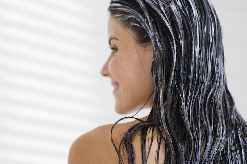 Woman with conditioner in her hair