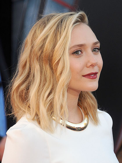 "HOLLYWOOD, CA - APRIL 13: Actress Elizabeth Olsen arrives at the Los Angeles premiere of Marvel's ""Avengers: Age Of Ultron"" at Dolby Theatre on April 13, 2015 in Hollywood, California. (Photo by Gregg DeGuire/WireImage)"