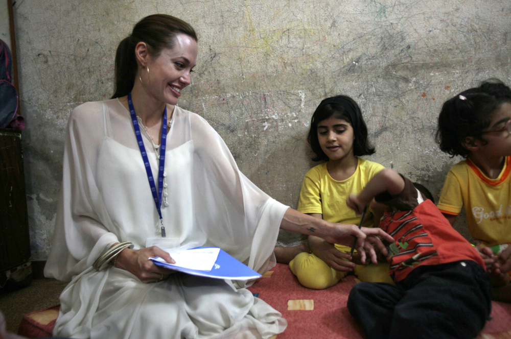 JARAMANA, SYRIA - OCTOBER 02: UNHCR Goodwill Ambassador actress Angelina Jolie (R) visits an Iraqi refugee family living in a suburb on October 2, 2009 in Jaramana, near Damascus, Syria. Jolie, traveling with partner Brad Pitt, last visited Damascus in 2007. (Photo by Salah Malkawi/Getty Images)