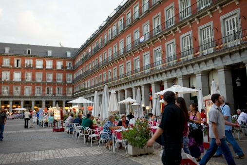 Tourists at a sidewalk cafe, Plaza Mayor, Madrid, Spain