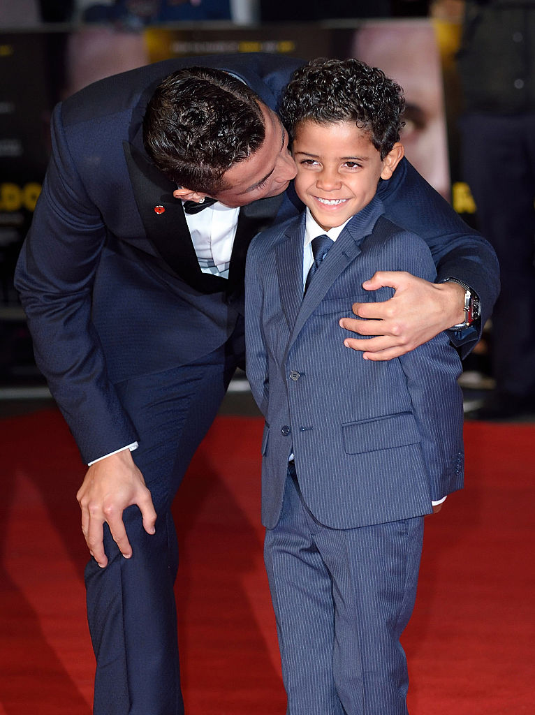 "LONDON, ENGLAND - NOVEMBER 09: Cristiano Ronaldo and son Cristiano Ronaldo Jnr attend the World Premiere of ""Ronaldo"" at Vue West End on November 9, 2015 in London, England. (Photo by Karwai Tang/WireImage)"