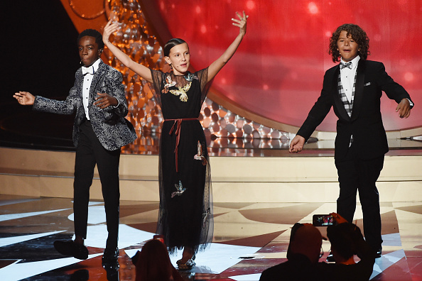 LOS ANGELES, CA - SEPTEMBER 18: (L-R) Actors Caleb McLaughlin, Millie Bobby Brown and Gaten Matarazzo perform onstage during the 68th Annual Primetime Emmy Awards at Microsoft Theater on September 18, 2016 in Los Angeles, California. (Photo by Kevin Winter/Getty Images)