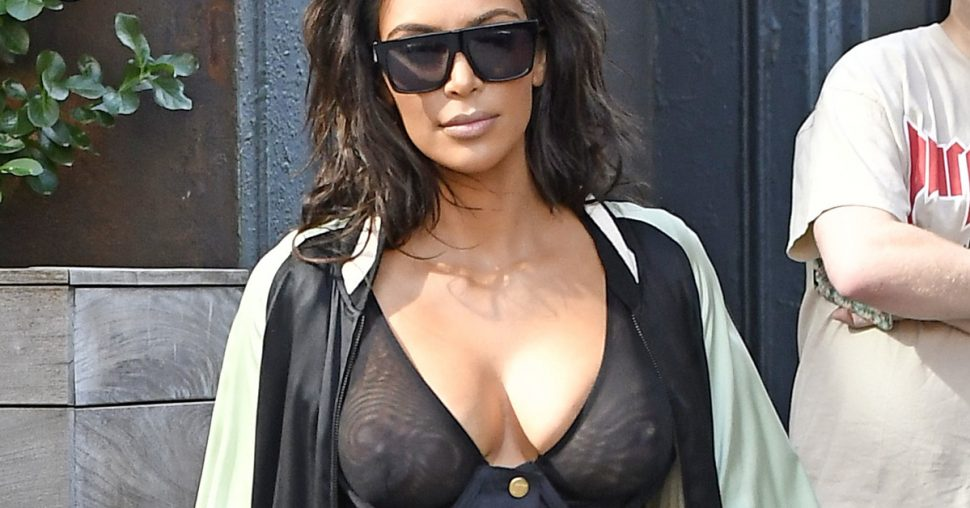Kim Kardashian wears a see-through bustier corset showing her cleavage while exiting her New York AirBnb apartment with Kanye following behind on their way to Kanye's concert in Toronto  Pictured: Kim Kardashian; Kanye Ref: SPL1342795  300816   Picture by: srpp/ Splash News  Splash News and Pictures Los Angeles:310-821-2666 New York:212-619-2666 London:870-934-2666 photodesk@splashnews.com