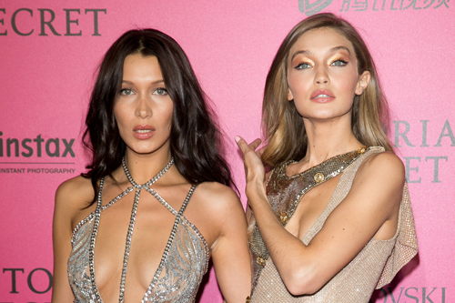 PARIS, FRANCE - NOVEMBER 30: (L-R) Bella Hadid and Gigi Hadid attend '2016 Victoria's Secret Fashion Show' after show photocall at Le Grand Palais on November 30, 2016 in Paris, France. (Photo by Marc Piasecki/WireImage)