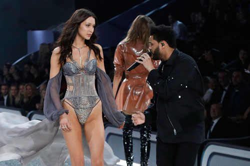 PARIS, FRANCE - NOVEMBER 30: The Weeknd performs as Bella Hadid walks the runway during the 2016 Victoria's Secret Fashion Show at Le Grand Palais on November 30, 2016 in Paris, France. (Photo by Taylor Hill/WireImage)
