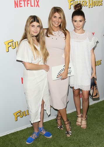 LOS ANGELES, CA - FEBRUARY 16:  Lori Loughlin (C) and daughters Isabella Giannulli (L) and Olivia Giannulli attend the premiere of Netflix's 'Fuller House' on February 16, 2016 in Los Angeles, California. (Photo by JB Lacroix/WireImage)