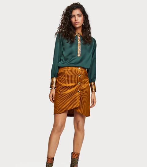 Stylish cocoonen: de corduroy rok tegen de winterblues